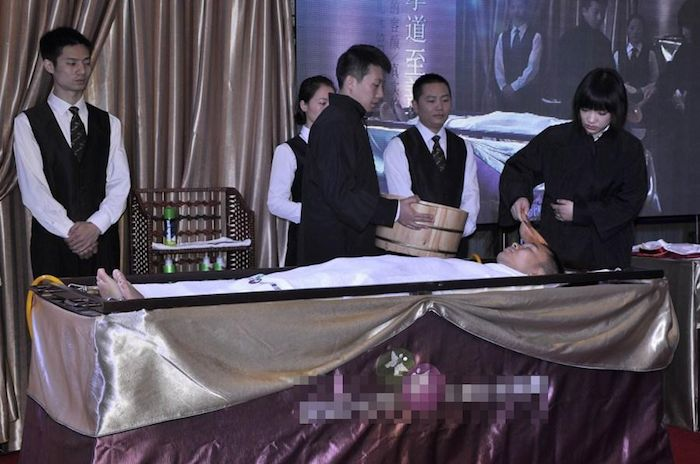 Chinese Mortuary providing massage to the deads